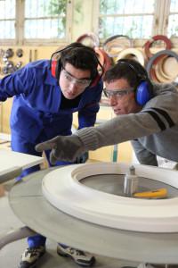Carpenter and apprentice in workshop shutterstock_64364530
